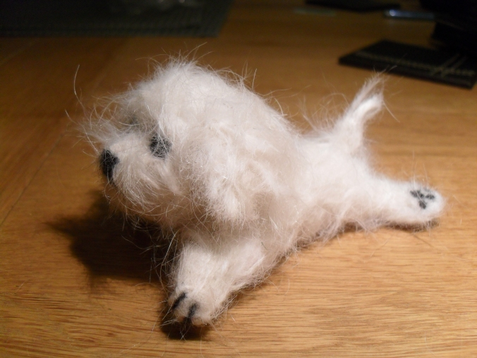 Needle felting using dog hair.