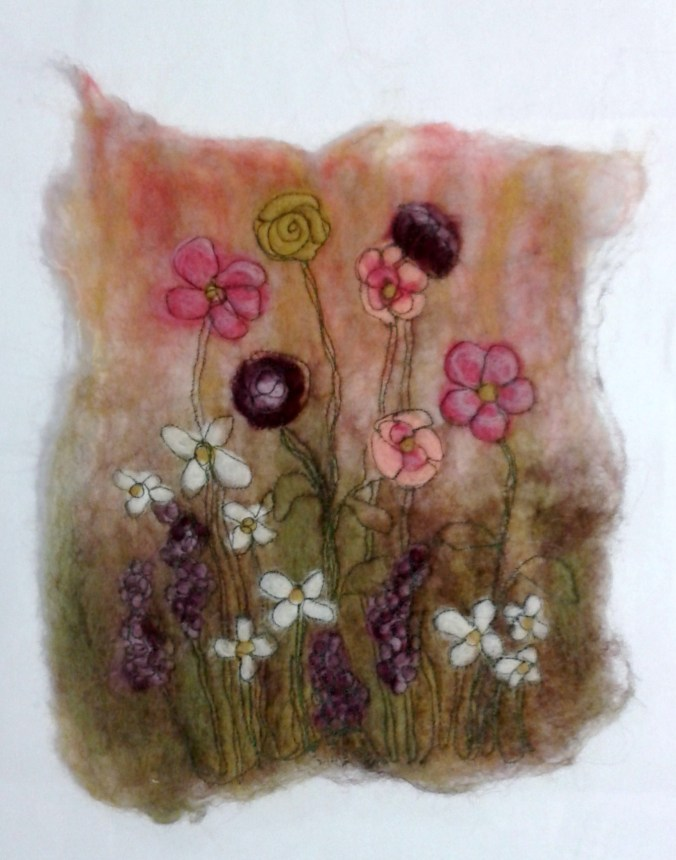 My version of the Flower Meadow using wet and dry felting and machine stitching.