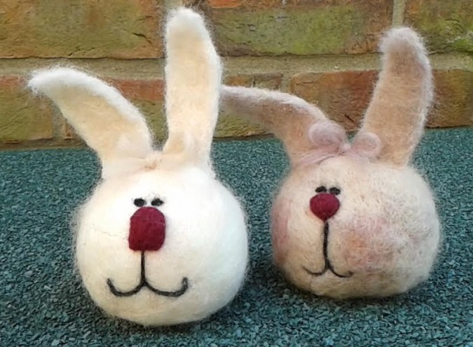 Easter bunnies needle felted using Merino wool onto a polystyrene ball.