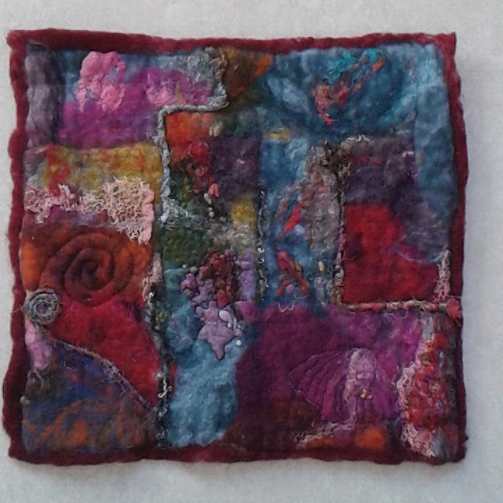 A wet felted abstract picture.