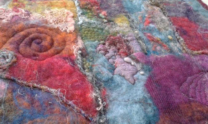 Detail of abstract wet felted picture