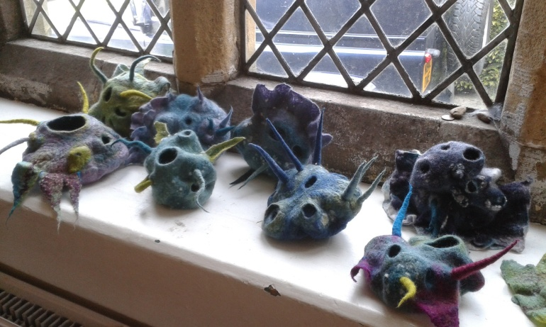 Eight of the finished vessels displayed on a window ledge. looking particularly alien-like