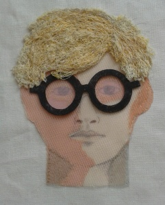 Portrait of Hockney made from fabric and thread.