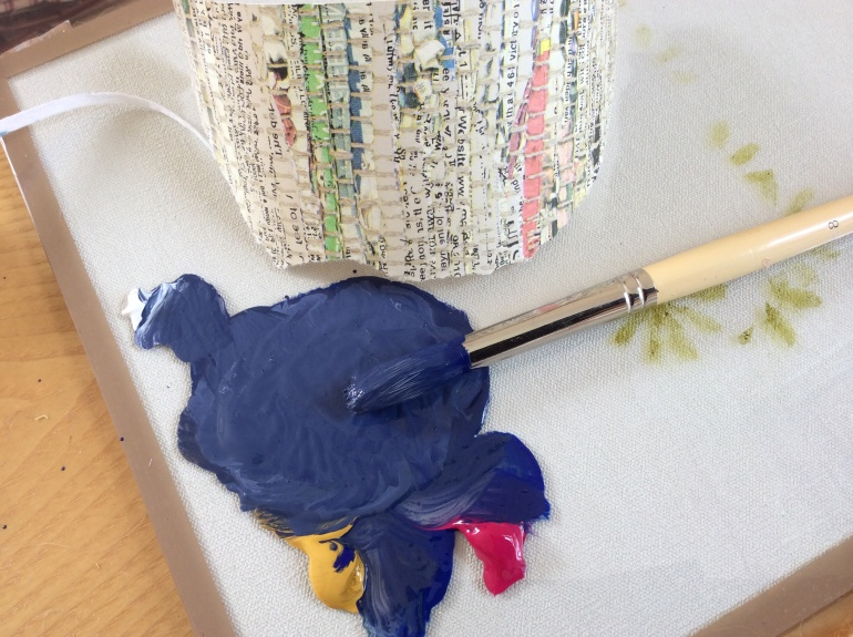 Acrylic paint is mixed to compliment the blue seen in the Newsprint wallpaper.