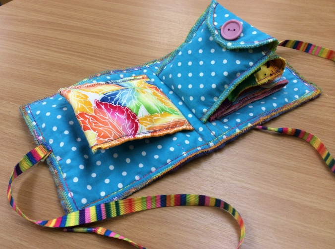 Bright, multicoloured kiddies pocket book.