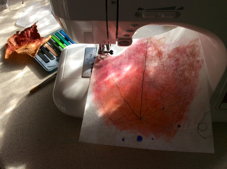 A photograph showing my painted leaf having the veins sewn on using my Janome sewing machine