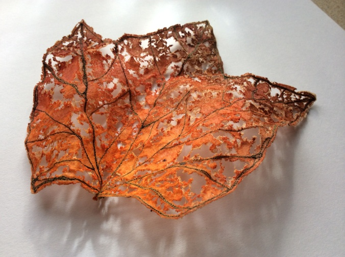 A handmade leaf skeleton with a beautiful lace effect created by heat distressing the fabric.