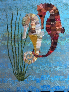 A colourful quilt featuring two seahorses.