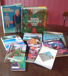 A selection of David Hockney books displayed on a table.