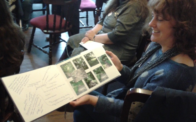 An open sketchbook showing photographs of the countryside on the right and hand written notes on the left.