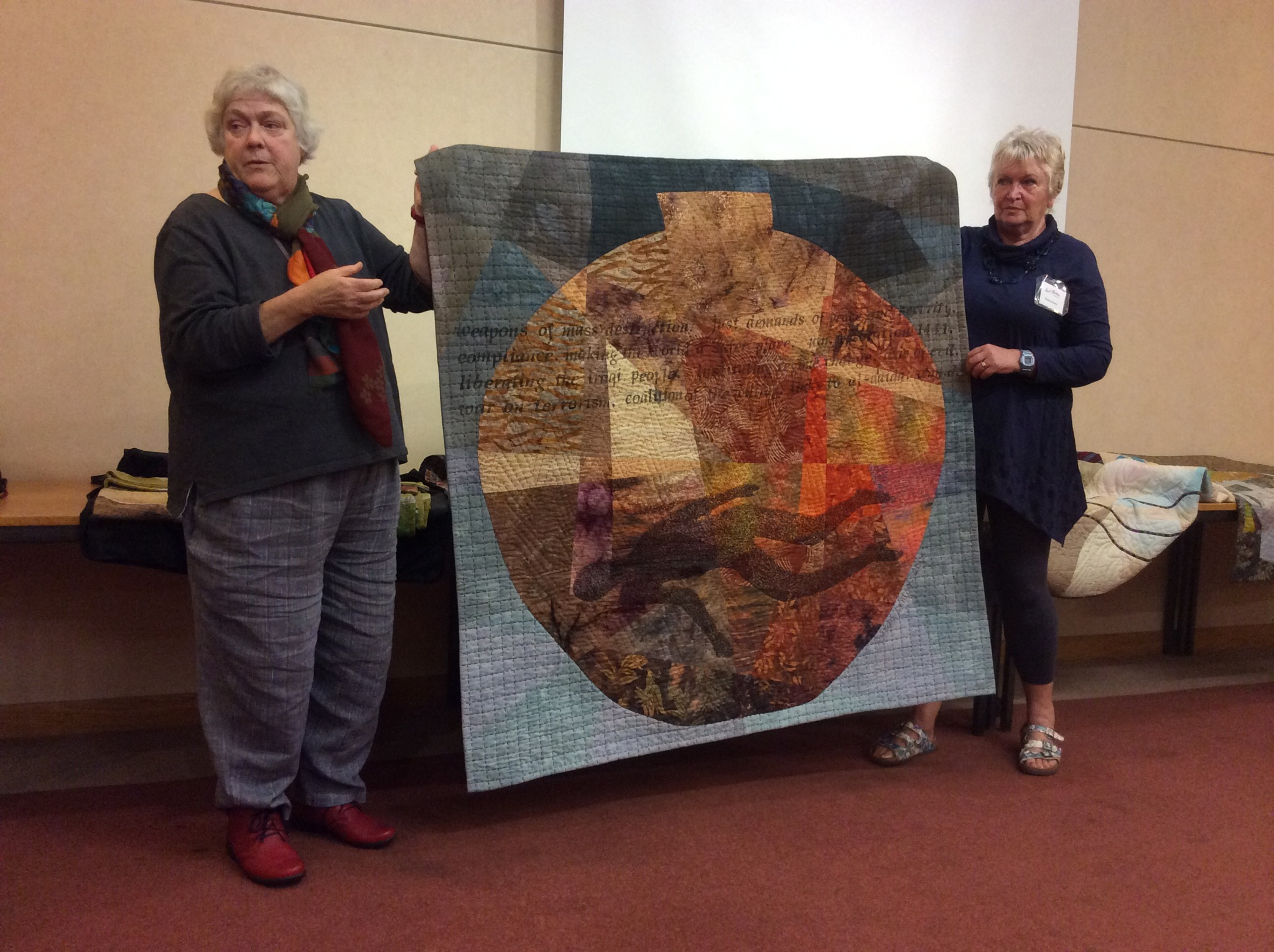 Susan Denton and Sheila Evans hold up one of the quilts on show at the quilting workshop