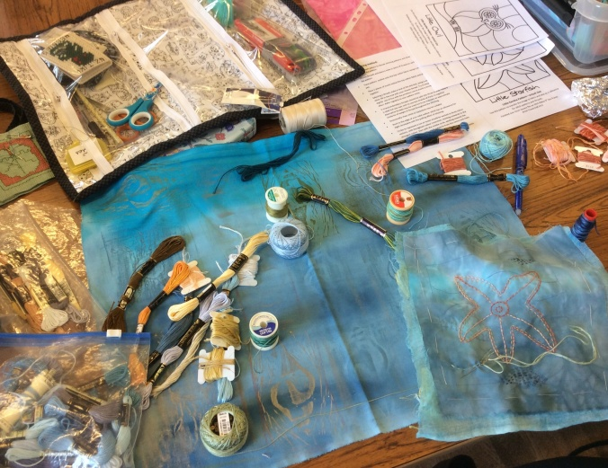 Hand dyed and stamped blue fabrics with assorted threads, selected for the Kantha workshop at Cranwell Village Hall.