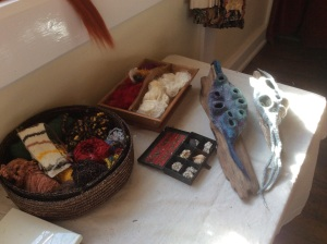 Two examples of Jenny's work displayed with the shells which were her inspiration.