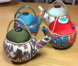 Multicoloured teapot pincushions