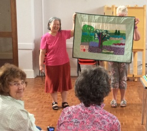 Molly proudly shows off her quilt at the show and tell session.