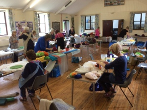 Room full of ladies at a wet felting workshop in Arnesby Village Hall