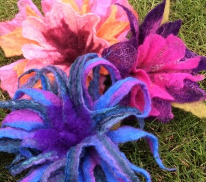 Wet felted flowers made with multiple resists