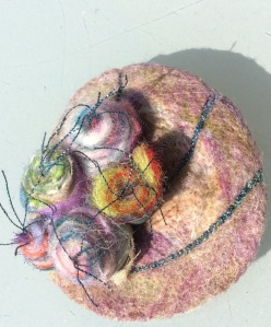 Wet felted brooch with tiny felt and organza flowers