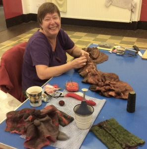 "Annemie demonstrates how to make felt ""with patience and love""."
