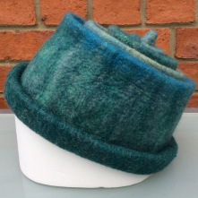 Wet felted Merino concertina hat in shades of blue and green