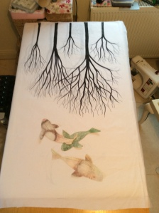 The first stage of the art quilt A Tribute to Three Worlds....trees and fish are painted and in position.