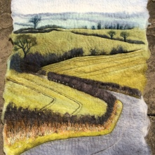 This image is of a wet Felted Wallhanging. The subject matter is the Lincolnshire Wolds